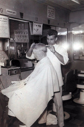 Old shot of Sal cutting hair.