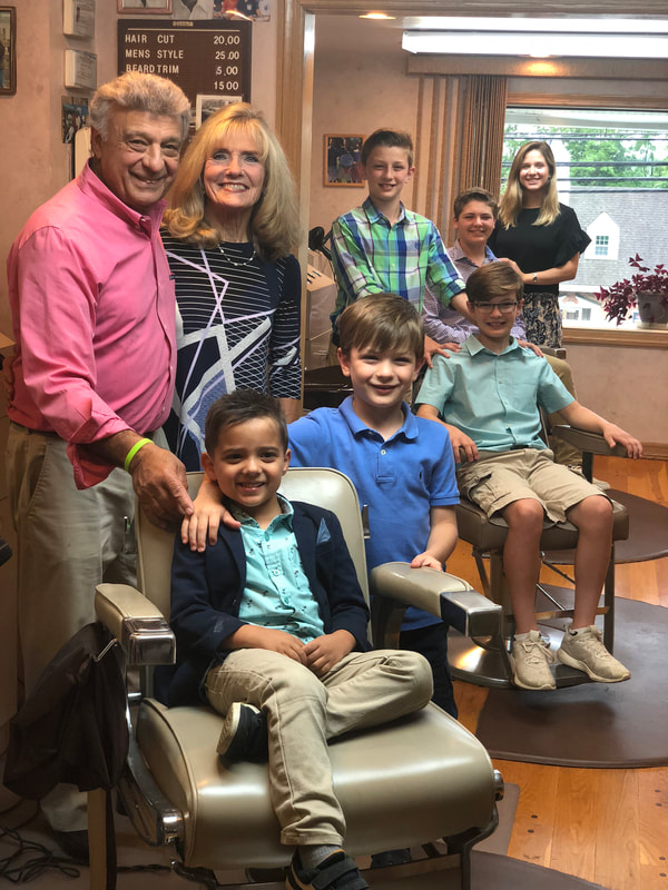 Sal and his wife with grandkids in Barber Shop